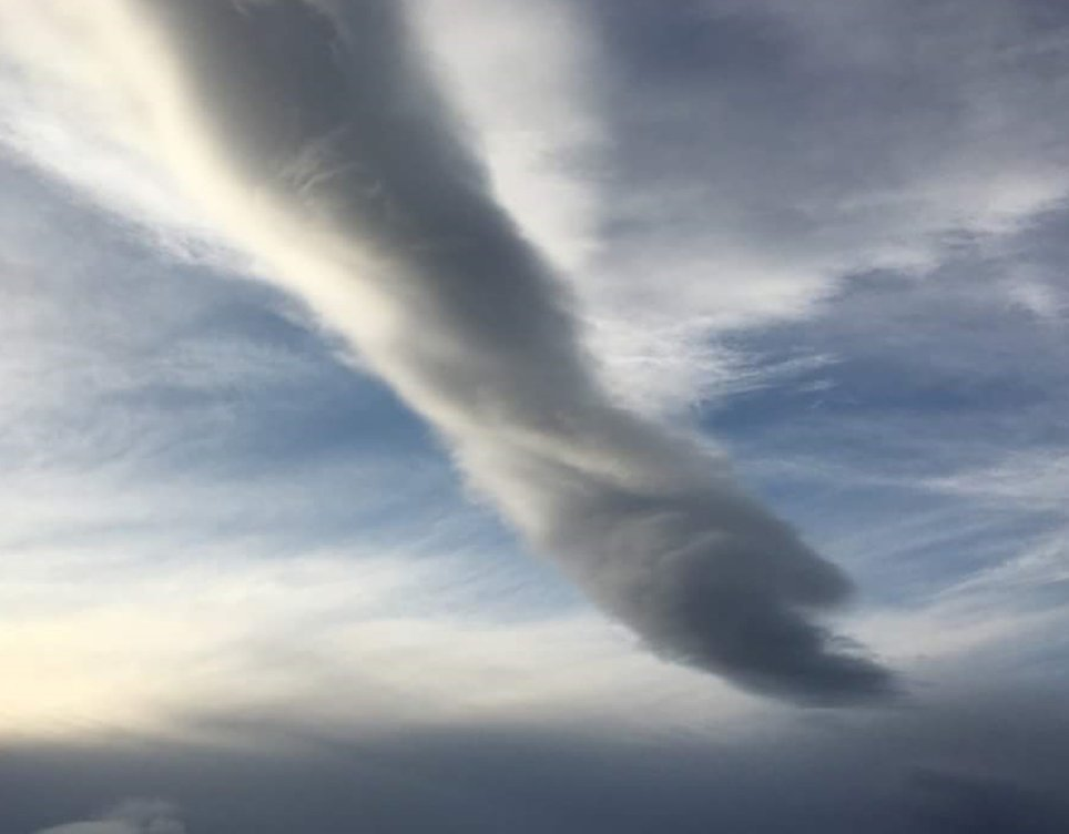 """Forget Maradona, could these snaps show the real hand of God?  The jaw-dropping formations were captured by Louise Taylor, 30, as she travelled through Scotland. They were taken near Tore in the Highlands, on the way to Dingwall.  Amazingly, Louise only rediscoved the pictures, taken in February 2016, when she was looking through an old iPhone this week.  Louise, from Kinlochewe, explains: """"The photos were taken on an iPhone while travelling. It formed before a major wind storm hit Scotland. It's a form of twisted lenticular cloud. The oddest cloud I've ever seen that's for sure. Being in the weather photography game for a while, I know people prefer the strange and let's say """"religious"""" meaning of clouds rather than what they actually are. I'm fantasizing about a big hand coming down scooping billions of midges up.""""  After posting one of the pictures online Saturday (2 June), the celestial vision has prompted interesting comments. Ana Maria Cerrudo said: """"Looks like an arm coming down with a hand palm up"""", Andy Houliston wrote """"The Scottish version of a fist full of dollars. A handful of clouds"""", and Victoria Mcalpine commented """"It's the hand of god, where's Maradona?"""".  Where: Tore, United Kingdom When: 02 Feb 2016 Credit: Louise Taylor/Cover Images  **All usages and enquiries, please contact  info@cover-images.com - +44 (0)20 3397 3000Editorial use only**"""